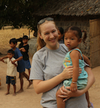 Denise takes five from video production with a new friend she made while volunteering in Cambodia.