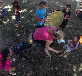 Volunteers in Honduras help with a video shoot